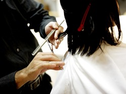 Hyder AK hair design student cutting hair